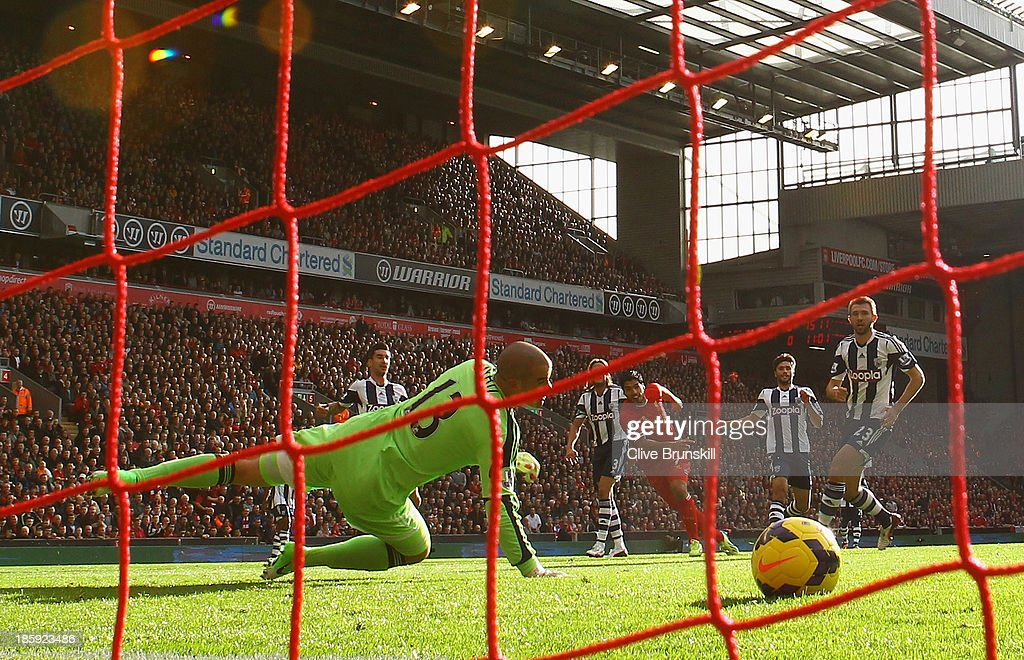 Luis Suarez of Liverpool scores the opening goal during the Barclays Premier League match between Liverpool and West Bromwich Albion at Anfield on October 26, 2013 in Liverpool, England.