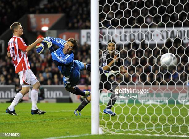 Luis Suarez of Liverpool scores the second during the Carling Cup Fouth Round match between Stoke City and Liverpool at Britannia Stadium on October...