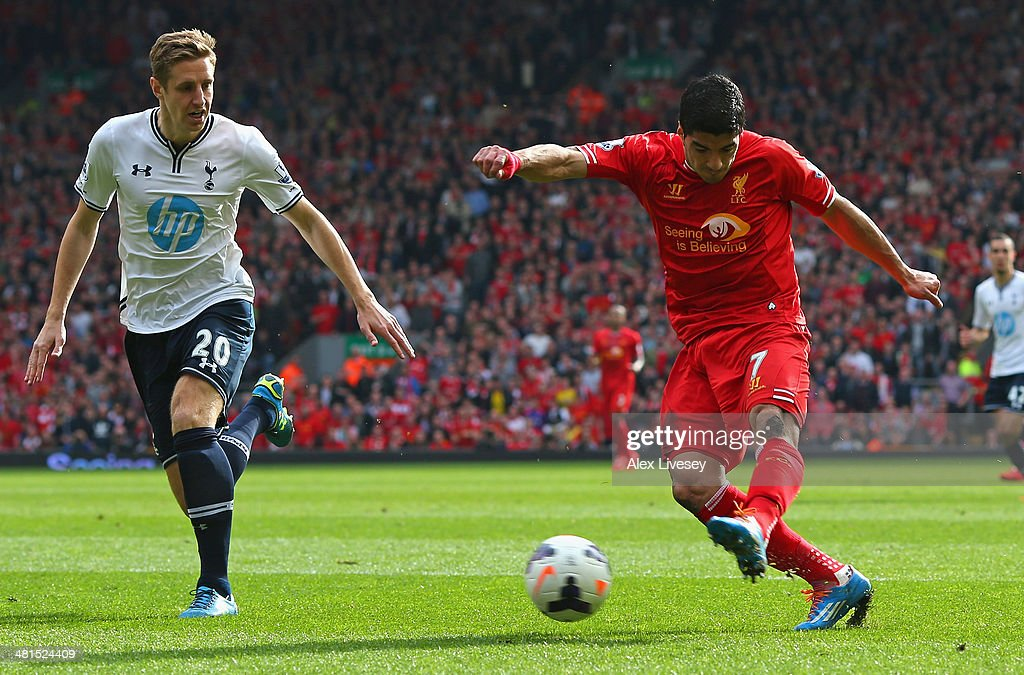 Luis Suarez of Liverpool scores the second goal during the Barclays Premier League match between Liverpool and Tottenham Hotspur at Anfield on March 30, 2014 in Liverpool, England.