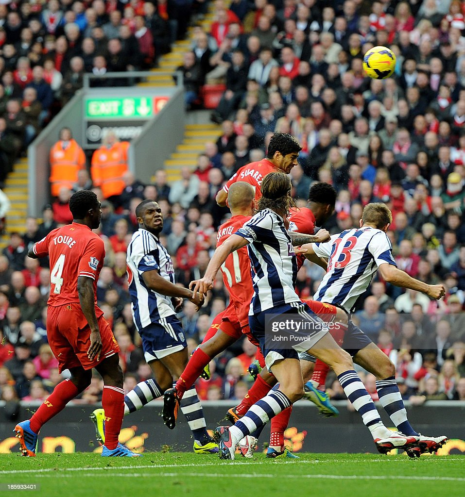 Luis Suarez of Liverpool scores the third goal during the Barclays Premier League match between Liverpool and West Bromwich Albion at Anfield on October 26, 2013 in Liverpool, England.
