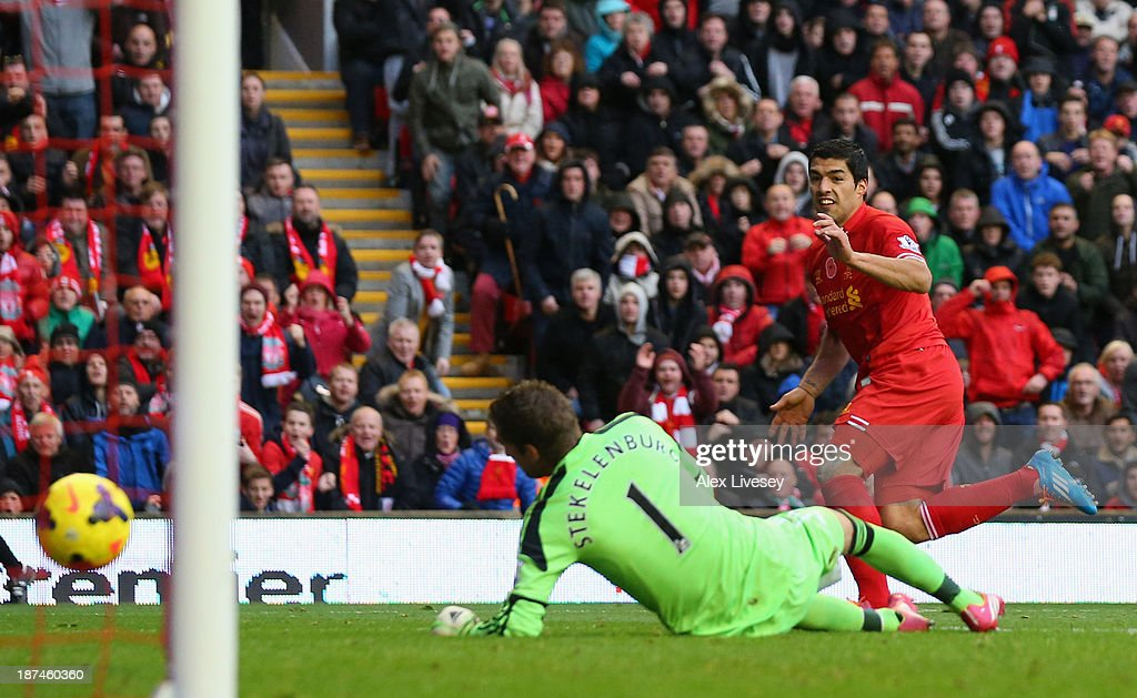 Luis Suarez of Liverpool scores the third goal during the Barclays Premier League match between Liverpool and Fulham at Anfield on November 9, 2013 in Liverpool, England.