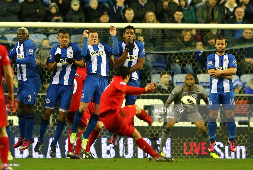 Luis Suarez of Liverpool scores the third goal from a free kick during the Barclays Premier League match between Wigan Athletic and Liverpool at the DW Stadium on March 2, 2013 in Wigan, England.