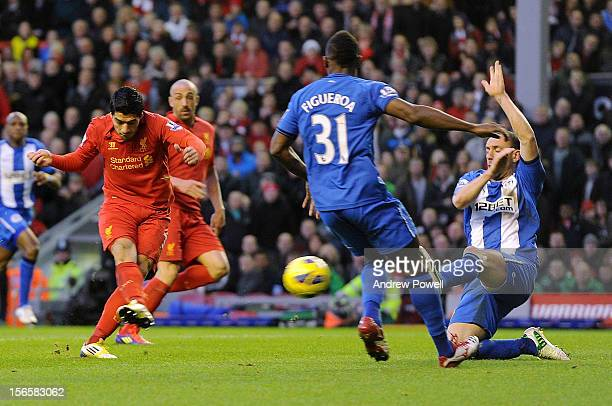 Luis Suarez of Liverpool scores to make it 10 during the Barclays Premier League match between Liverpool and Wigan Athletic at Anfield on November 17...