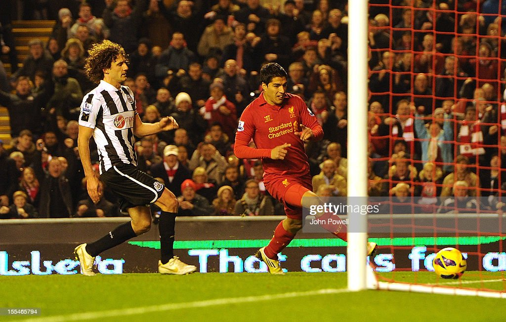 Luis Suarez of Liverpool scores to make it 1-1 during the Barclays Premier League match between Liverpool and Newcastle United at Anfield on November 4, 2012 in Liverpool, England.