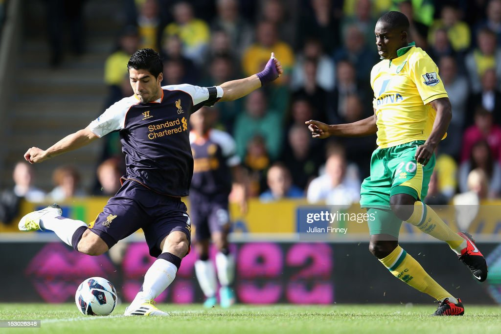 Luis Suarez of Liverpool shoots and scores their first goal during the Barclays Premier League match between Norwich City and Liverpool at Carrow Road on September 29, 2012 in Norwich, England.