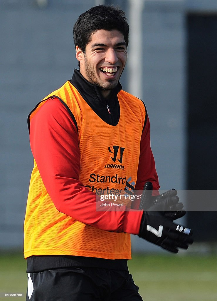 Luis Suarez of Liverpool smiles during a training session at Melwood Training Ground on February 28, 2013 in Liverpool, England.