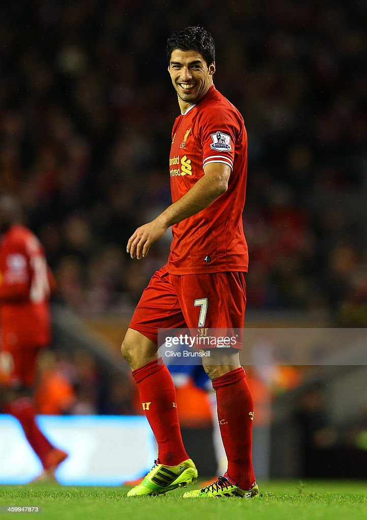 Luis Suarez of Liverpool smiles during the Barclays Premier League match between Liverpool and Hull City at Anfield on January 1, 2014 in Liverpool, England.