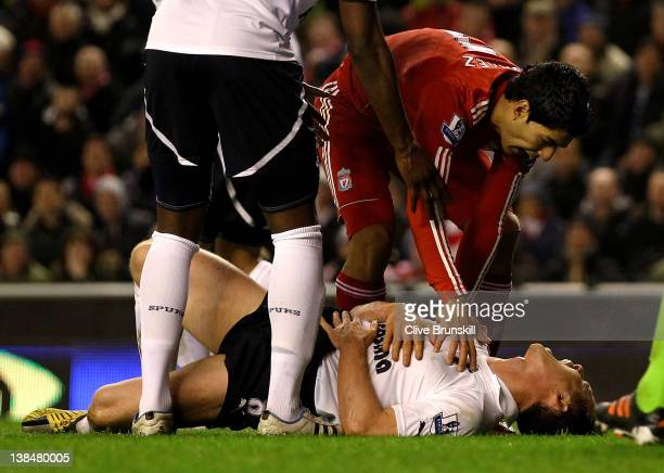 Luis Suarez of Liverpool speaks to Scott Parker of Tottenham Hotspur after challenging him during the Barclays Premier League match between Liverpool...