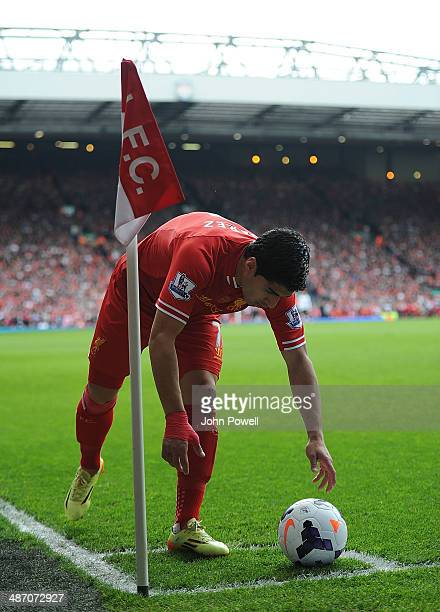 Luis Suarez of Liverpool takes a corner during the Barclays Premier League match between Liverpool and Chelsea at Anfield on April 27 2014 in...