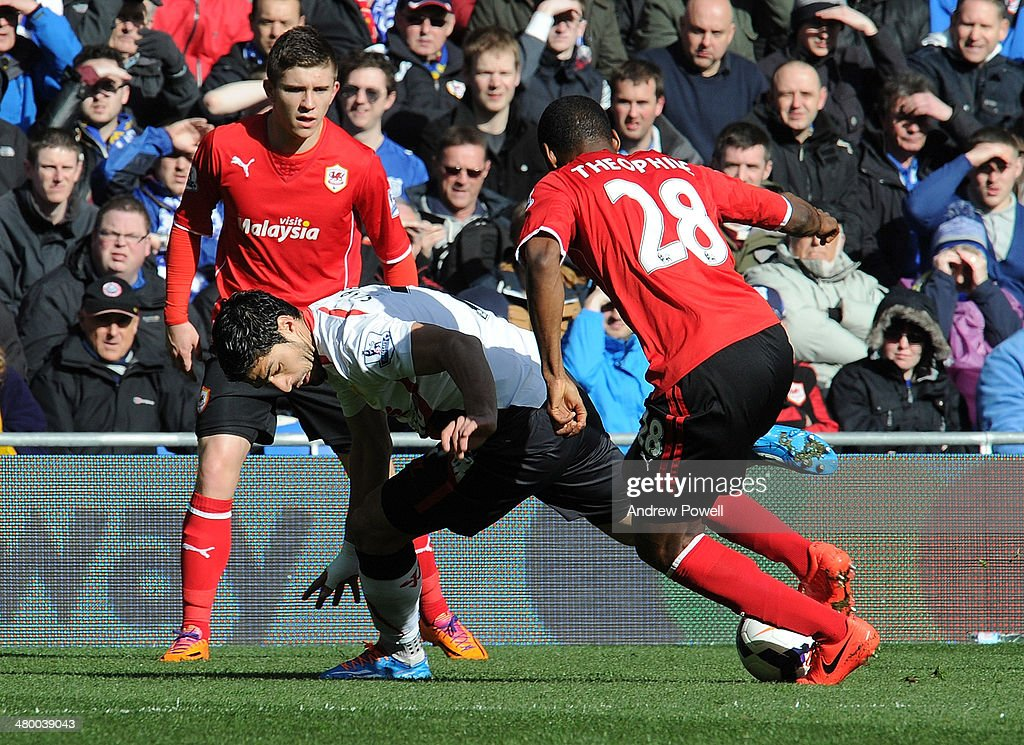 Luis Suarez of Liverpool takes it past Kevin Theophile-Catherine of Cardiff City during the Barclays Premier League match between Cardiff City and Liverpool at Cardiff City Stadium on March 22, 2014 in Cardiff, Wales.