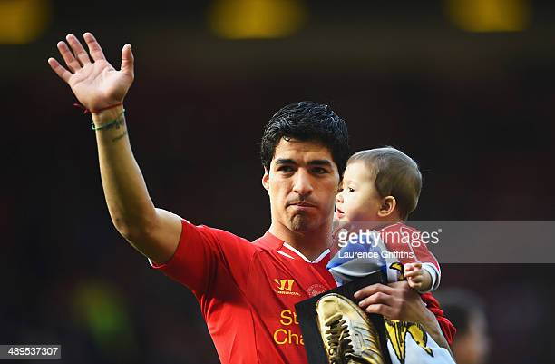 Luis Suarez of Liverpool with his son Benjamin after the Barclays Premier League match between Liverpool and Newcastle United at Anfield on May 11...