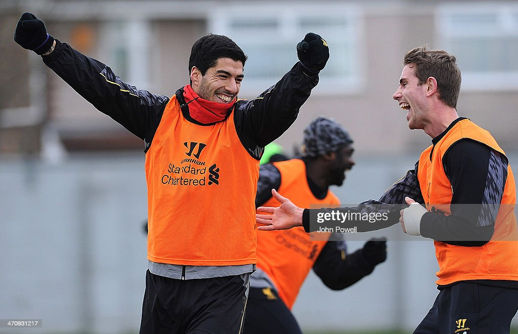 Luis Suarez of Liverpool (Left) with Jordan Henderson of Liverpool during a training session at Melwood Training Ground on February 21, 2014 in Liverpool, England.