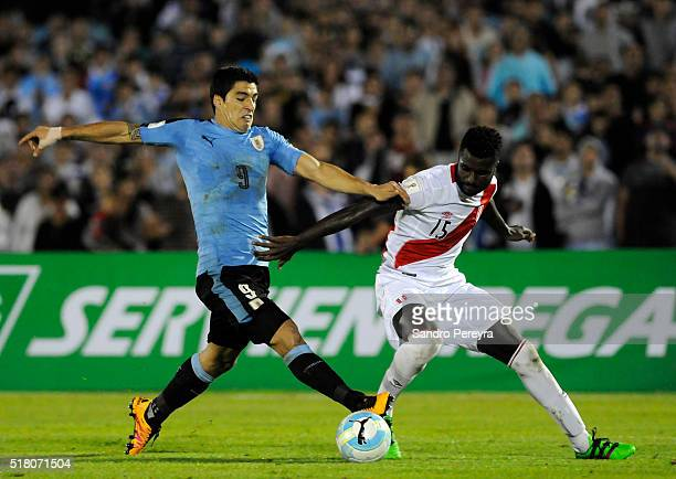 Luis Suarez of Uruguay and Christian Ramos of Peru fight for the ball during a match between Uruguay and Peru as part of FIFA 2018 World Cup...