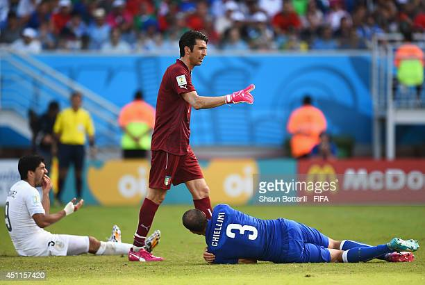 Luis Suarez of Uruguay and Giorgio Chiellini of Italy reacts after a clash during the 2014 FIFA World Cup Brazil Group D match between Italy and...