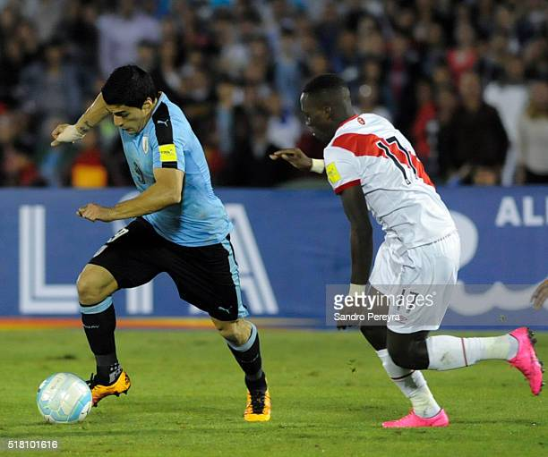 Luis Suarez of Uruguay and Luis Advincula of Peru fight for the ball during a match between Uruguay and Peru as part of FIFA 2018 World Cup...
