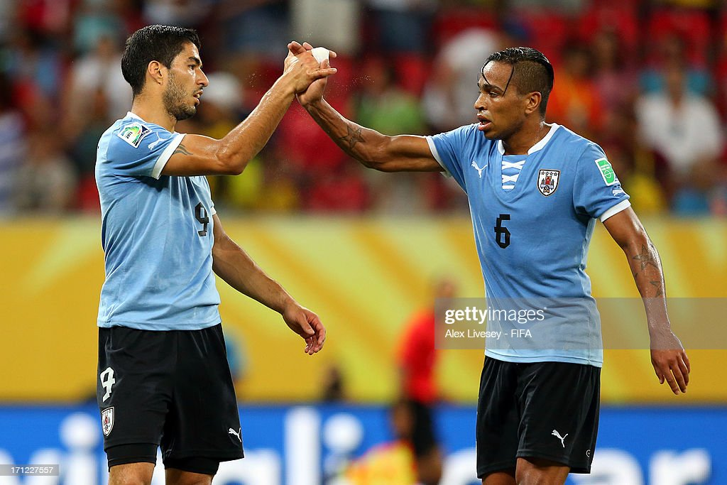 Luis Suarez of Uruguay celebrates after scoring a goal in the 90th minute with <a gi-track='captionPersonalityLinkClicked' href=/galleries/search?phrase=Alvaro+Pereira&family=editorial&specificpeople=2577731 ng-click='$event.stopPropagation()'>Alvaro Pereira</a> during the FIFA Confederations Cup Brazil 2013 Group B match between Uruguay and Tahiti at Arena Pernambuco on June 22, 2013 in Recife, Brazil.