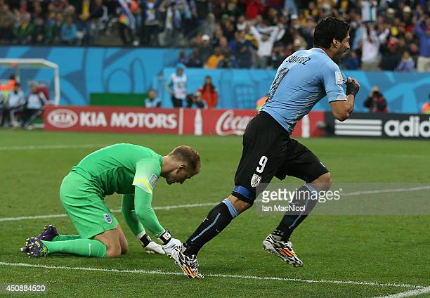 Luis Suarez of Uruguay celebrates scoring past England goalkeeper Joe Hart during the Group D match of the 2014 World Cup between England and Uruguay...