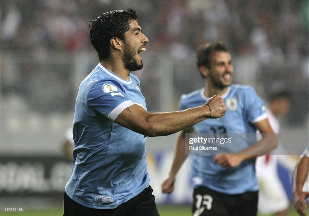 Luis Suarez of Uruguay celebrates the first goal during a match between Peru and Uruguay as part of the 15th round of the South American Qualifiers at Nacional Stadium on September 06, 2013 in Lima, Peru.