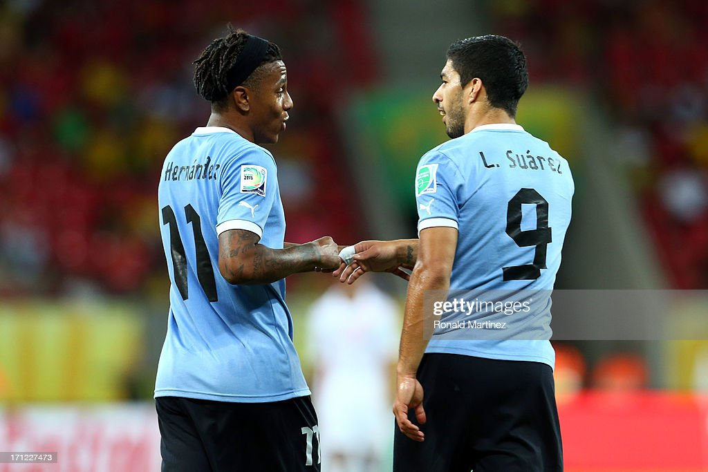 Luis Suarez of Uruguay celerbates with Abel Hernandez after scoring a goal in the 82nd minute during the FIFA Confederations Cup Brazil 2013 Group B match between Uruguay and Tahiti at Arena Pernambuco on June 22, 2013 in Recife, Brazil.
