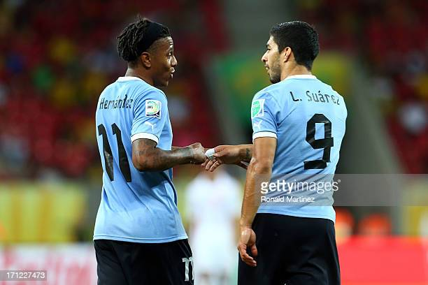Luis Suarez of Uruguay celerbates with Abel Hernandez after scoring a goal in the 82nd minute during the FIFA Confederations Cup Brazil 2013 Group B...