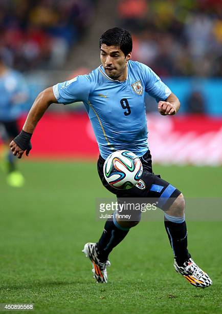 Luis Suarez of Uruguay controls the ball during the 2014 FIFA World Cup Brazil Group D match between Uruguay and England at Arena de Sao Paulo on...