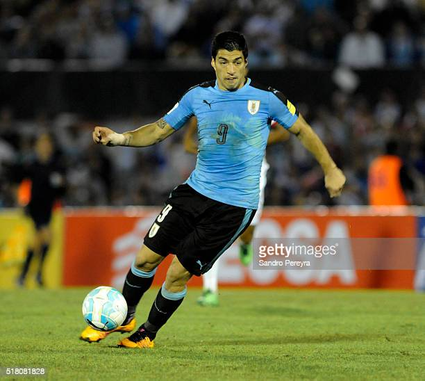 Luis Suarez of Uruguay drives the ball during a match between Uruguay and Peru as part of FIFA 2018 World Cup Qualifiers at Centenario Stadium on...