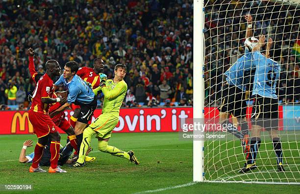 Luis Suarez of Uruguay handles the ball on the goal line for which he is sent off during the 2010 FIFA World Cup South Africa Quarter Final match...