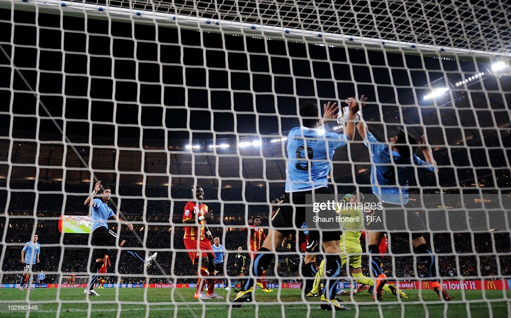Luis Suarez of Uruguay handles the ball on the goal line, for which he is sent off during the 2010 FIFA World Cup South Africa Quarter Final match between Uruguay and Ghana at the Soccer City stadium on July 2, 2010 in Johannesburg, South Africa.