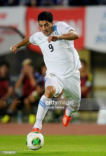 Luis Suarez of Uruguay in action during the international friendly match between Japan and Uruguay at Miyagi Stadium on August 14 2013 in Rifu Miyagi...