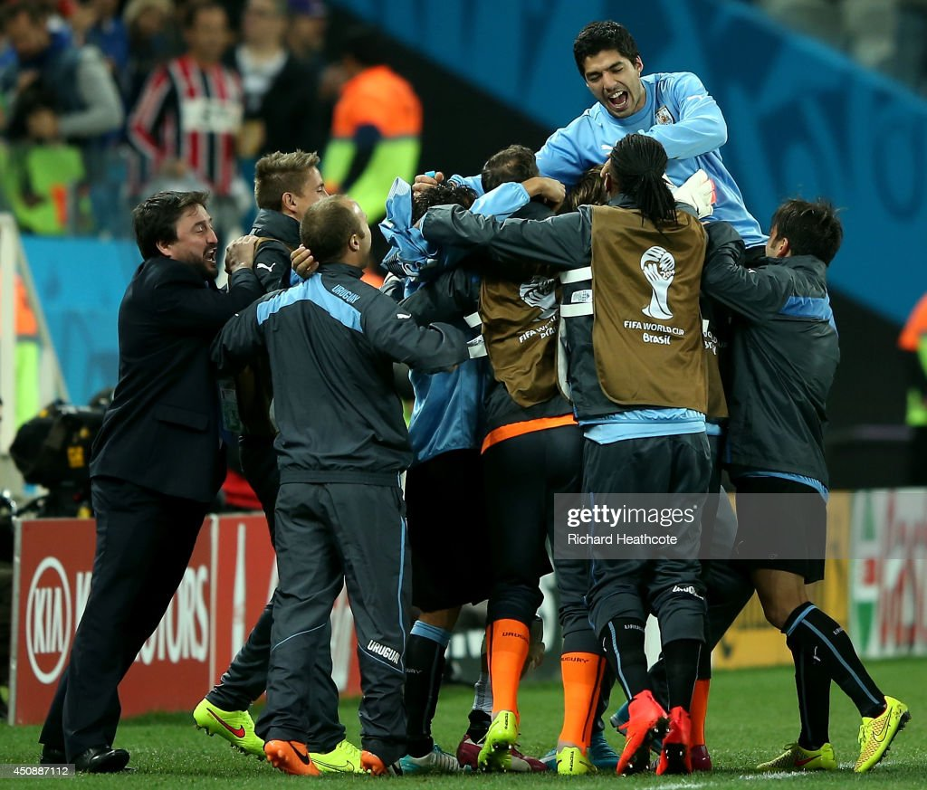 Luis Suarez of Uruguay is lifted up by teammates in celebration after defeating England 2-1 during the 2014 FIFA World Cup Brazil Group D match between Uruguay and England at Arena de Sao Paulo on June 19, 2014 in Sao Paulo, Brazil.