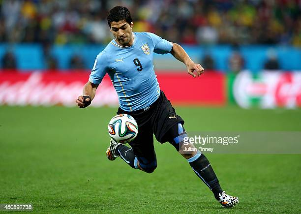Luis Suarez of Uruguay kicks the ball during the 2014 FIFA World Cup Brazil Group D match between Uruguay and England at Arena de Sao Paulo on June...