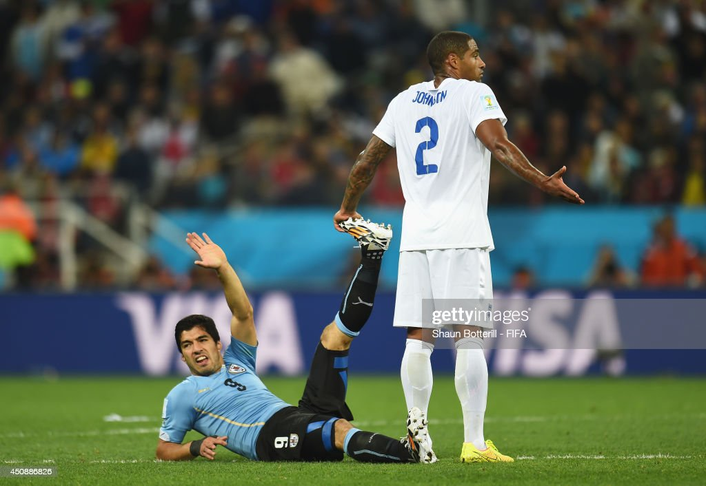 Luis Suarez of Uruguay lies injured during the 2014 FIFA World Cup Brazil Group D match between Uruguay and England at Arena de Sao Paulo on June 19, 2014 in Sao Paulo, Brazil.