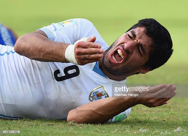 Luis Suarez of Uruguay reacts during the 2014 FIFA World Cup Brazil Group D match between Italy and Uruguay at Estadio das Dunas on June 24 2014 in...