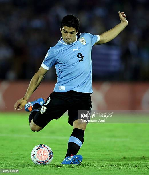 Luis Suarez of Uruguay runs with the ball during leg 2 of the FIFA World Cup Qualifier match between Uruguay and Jordan at Centenario Stadium Stadium...