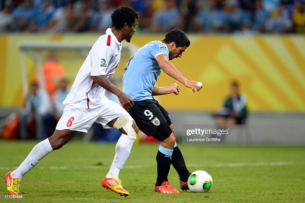 Luis Suarez of Uruguay scores a goal against Henri Caroine of Tahiti during the FIFA Confederations Cup Brazil 2013 Group B match between Uruguay and Tahiti at Arena Pernambuco on June 22, 2013 in Recife, Brazil.