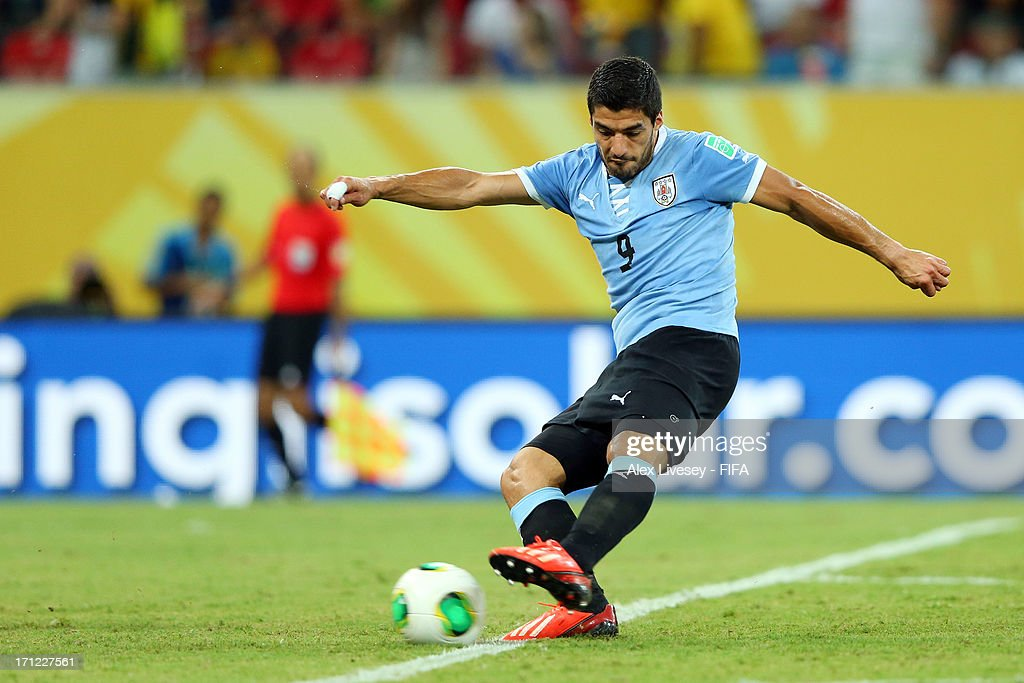 Luis Suarez of Uruguay scores a goal in the 90th minute during the FIFA Confederations Cup Brazil 2013 Group B match between Uruguay and Tahiti at Arena Pernambuco on June 22, 2013 in Recife, Brazil.