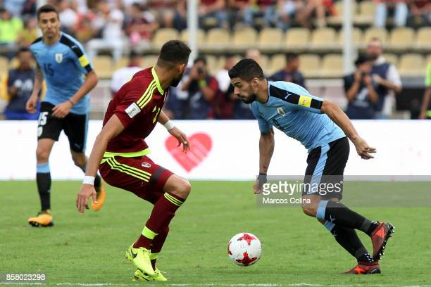 Luis Suarez of Uruguay trie to dribble Tomas Rincon of Venezuela during a match between Venezuela and Uruguay as part of FIFA 2018 World Cup...