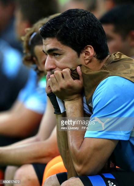 Luis Suarez of Uruguay watches from the bench during the 2014 FIFA World Cup Brazil Group D match between Uruguay and Costa Rica at Estadio Castelao...