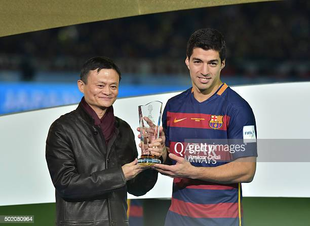 Luis Suarez poses for pictures after receiving the Player of the Game trophy during the FIFA Club World Cup final match between River Plate and FC...