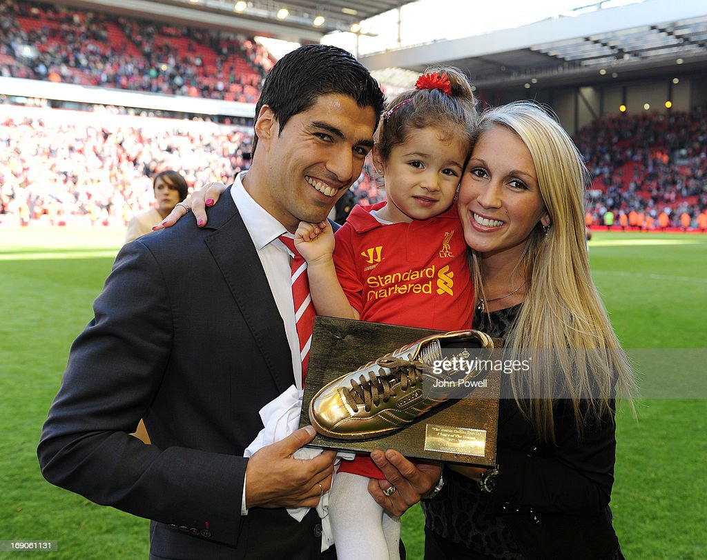 Luis Suarez poses with his daughter Delfina and wife Sofia at the end of the Barclays Premier League match between Liverpool and Queens Park Rangers at Anfield on May 19, 2013 in Liverpool England.