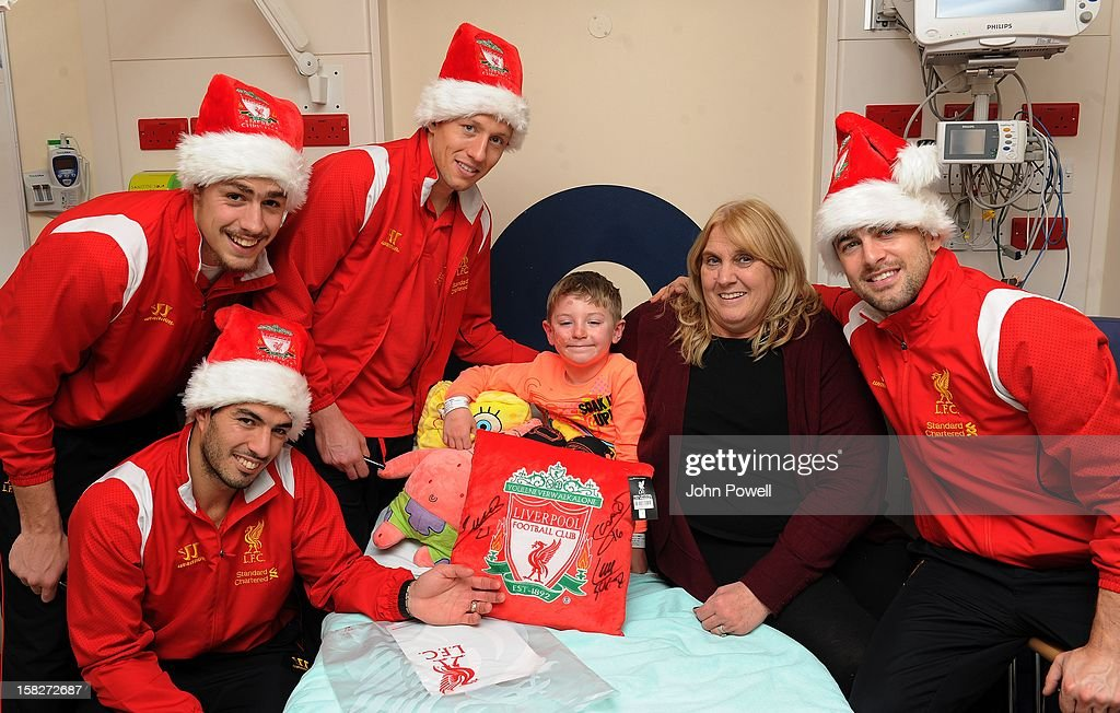 Luis Suarez, <a gi-track='captionPersonalityLinkClicked' href=/galleries/search?phrase=Sebastian+Coates&family=editorial&specificpeople=5678488 ng-click='$event.stopPropagation()'>Sebastian Coates</a>, <a gi-track='captionPersonalityLinkClicked' href=/galleries/search?phrase=Lucas+Leiva+-+Defensive+Midfielder+-+Born+1987&family=editorial&specificpeople=4114250 ng-click='$event.stopPropagation()'>Lucas Leiva</a> and <a gi-track='captionPersonalityLinkClicked' href=/galleries/search?phrase=Joe+Cole&family=editorial&specificpeople=171525 ng-click='$event.stopPropagation()'>Joe Cole</a> of Liverpool FC visit Alder Hey Children's Hospital on December 12, 2012 in Liverpool, England.