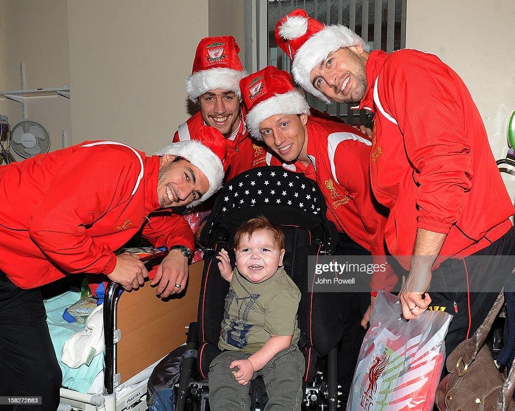 Luis Suarez, Sebastian Coates, Lucas Leiva and Sebastian Coates of Liverpool FC visit Alder Hey Children's Hospital on December 12, 2012 in Liverpool, England.