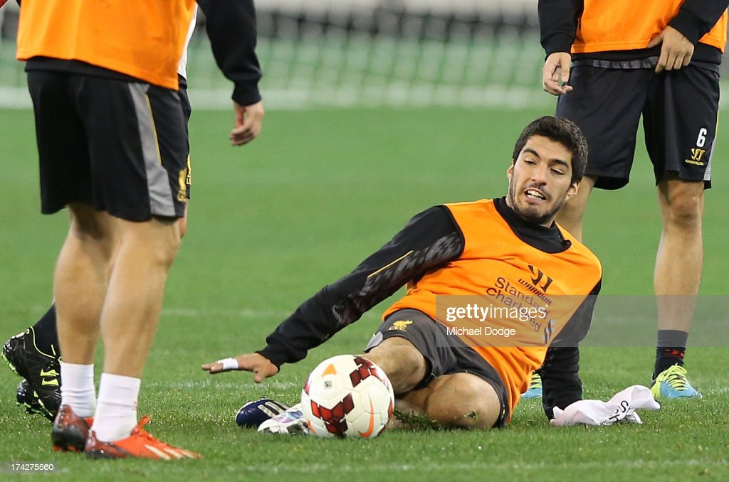 Luis Suarez slips over during a Liverpool FC training session at Melbourne Cricket Ground on July 23, 2013 in Melbourne, Australia.