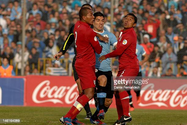 Luis Suarez tries to pass between two Peruvians during a match between Uruguay and Peru as part of the sith round of the South American Qualifiers...