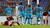 Luis Suarez with his teammates of FC Barcelona celebrates after scoring the opening goal the UEFA Champions League Group E match between AS Roma and...