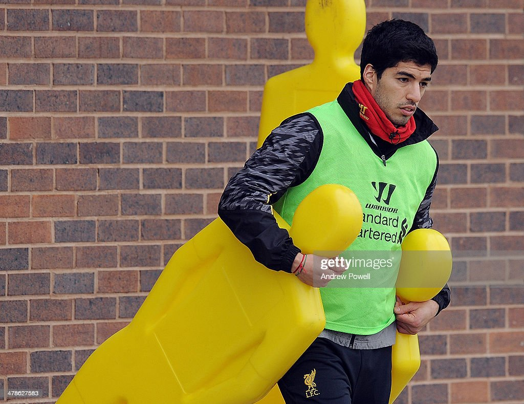 Luis Surez of Liverpool pulls out the practice dummies during a training session at Melwood Training Ground on March 14, 2014 in Liverpool, England.