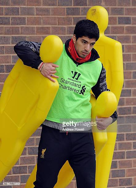 Luis Surez of Liverpool pulls out the practice dummies during a training session at Melwood Training Ground on March 14 2014 in Liverpool England