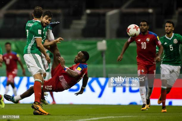 Luis Tejada of Panama struggles for the ball with Nestor Araujo of Mexico during the match between Mexico and Panama as part of the FIFA 2018 World...