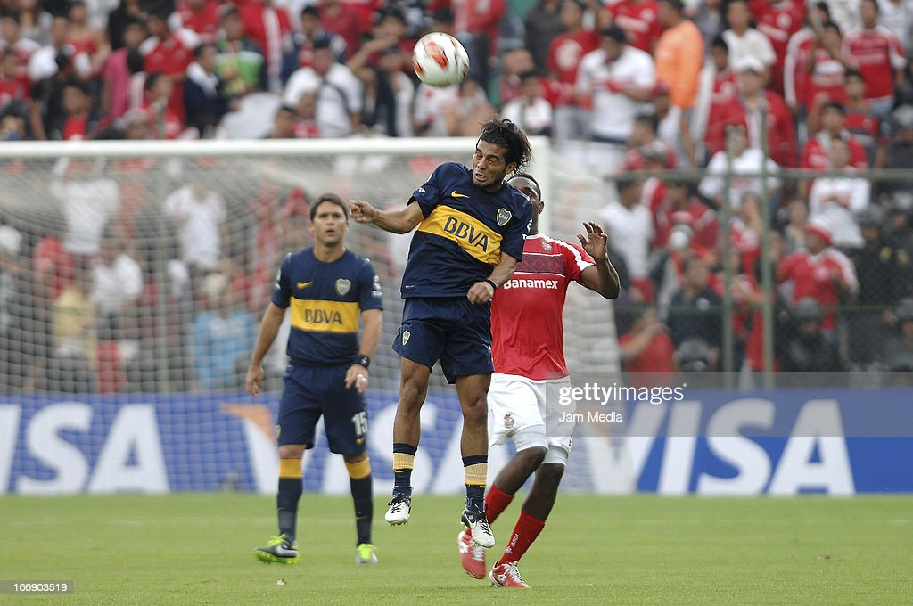 Luis Tejada (R) of Toluca struggles for the ball with Walter Erviti (L) of Boca Juniors during the match between Toluca from Mexico and Boca Jrs from Argentina as part of the Copa Bridgestone Libertadores 2013 at Nemesio Diez Stadium on April 17, 2013 in Toluca, Mexico.