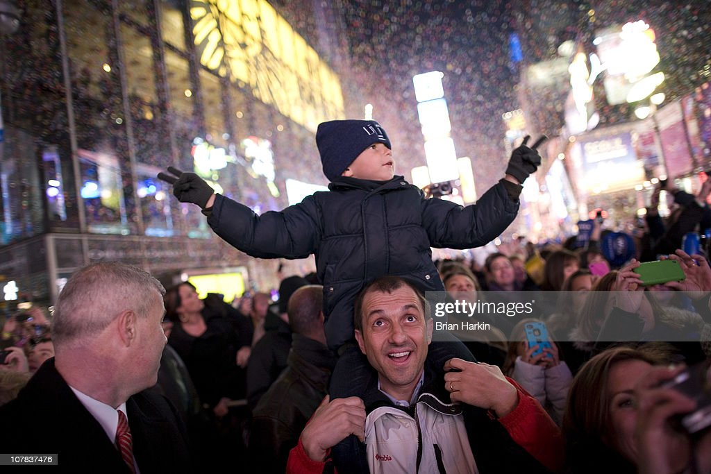Luis Tito, 6, celebrates atop the shoulders of his father, Jorge Tito, in Times Square just after the annual ball drop January 01, 2011 in New York City. This year a 11,875-pound Waterford crystal ball descended a 141-foot tall flagpole to mark the beginning of 2011.